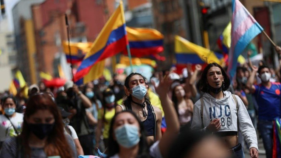 Demonstrators take part in a protest demanding government action to tackle poverty, police violence and inequalities in healthcare and education systems, in Bogota, Colombia, May 9, 2021