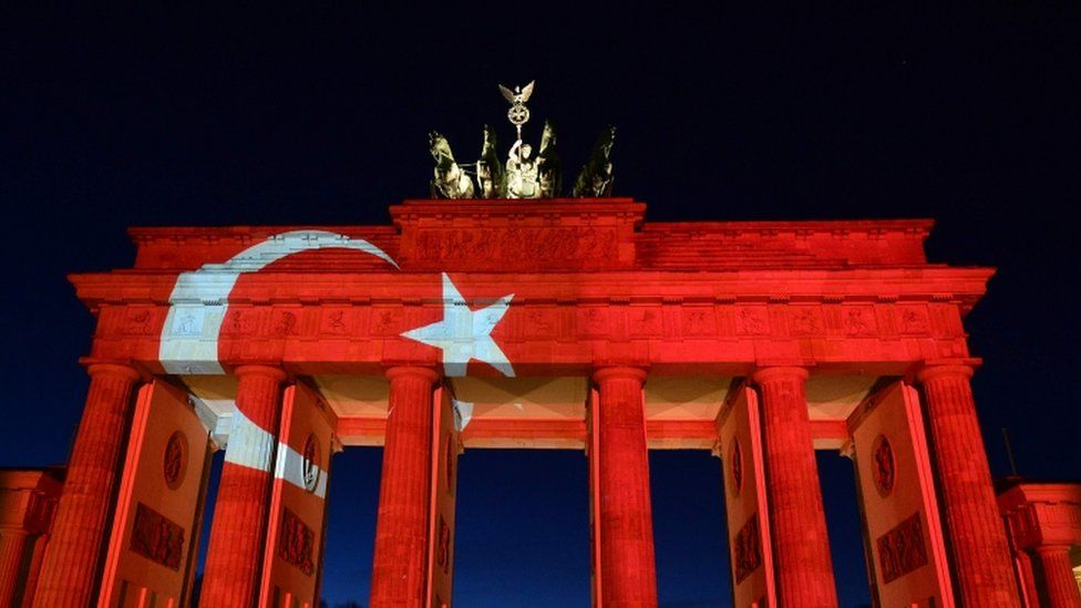 The Brandenburg Gate in Berlin is lit up in remembrance