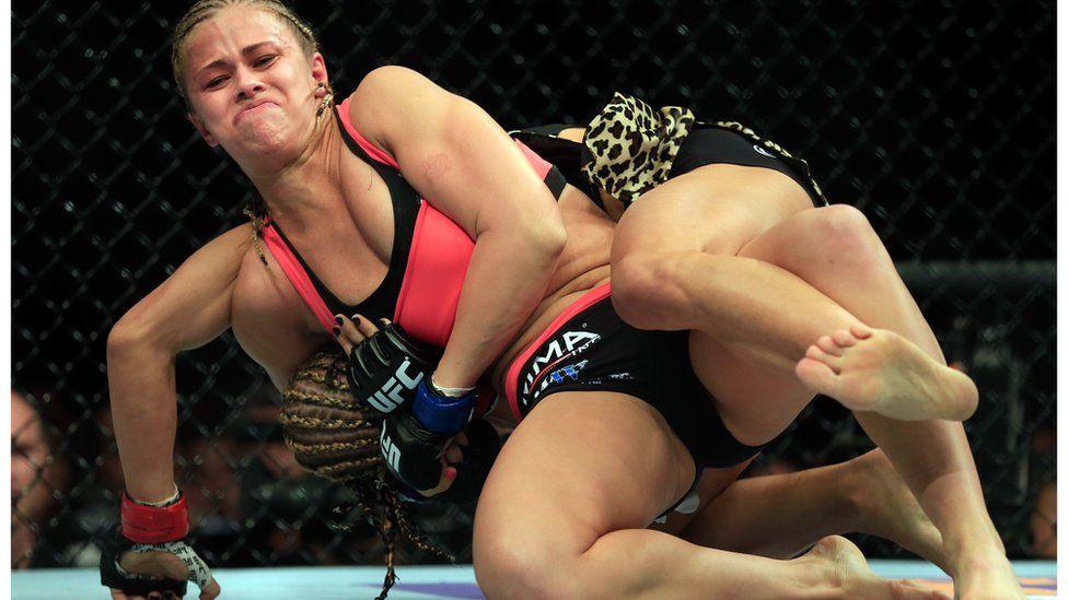 Paige VanZant fighting Felice Herrig.