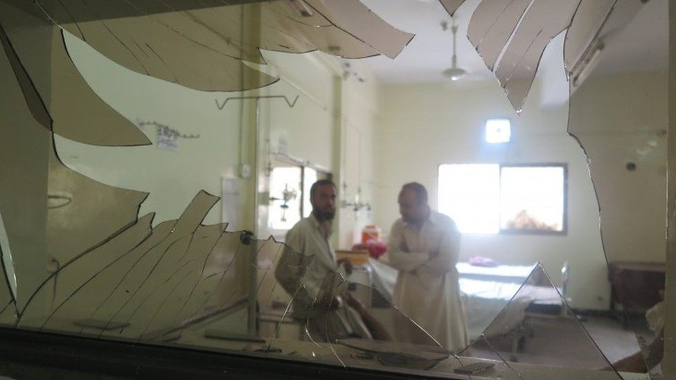 Hospital interior with broken window after blast