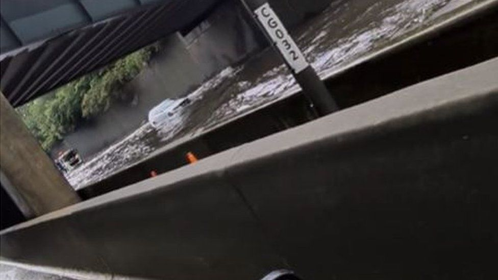 Screen grab from footage taken with permission from the Facebook page of Matt Hickmott of flash flooding on the M25, where it was also raining and hailing.