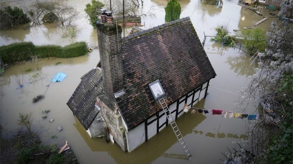 House surrounded by floodwater in Ironbridge