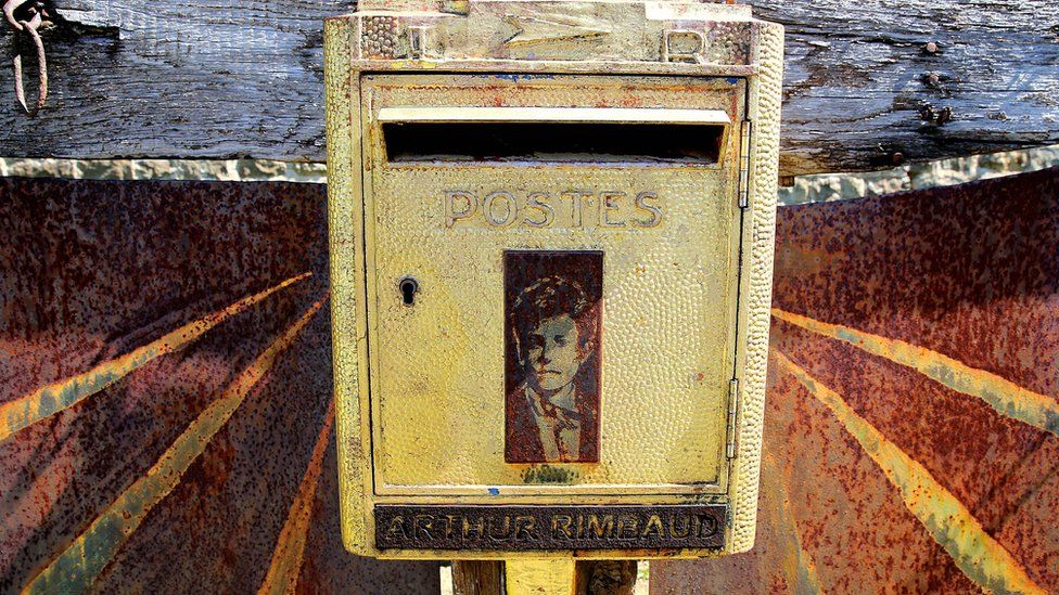 Over 120 years after Rimbaud's death, letters are still sent to this letter box in the cemetery where he is buried at Charleville-Mezieres
