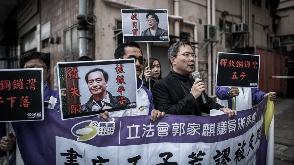 Members of the Civic party voice their concern about missing booksellers outside the China liaison office in Hong Kong on January 19, 2016.