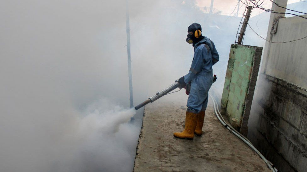 A man fumigating in Indonesia