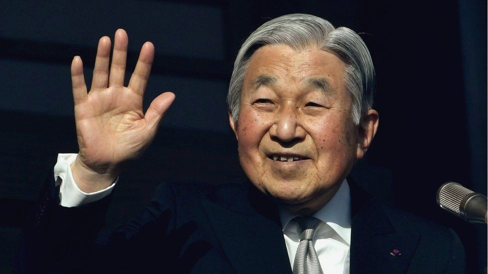 Japanese Emperor Akihito waves to well-wishers during his new year speech on the balcony of the Imperial Palace in Tokyo on 2 January 2017.