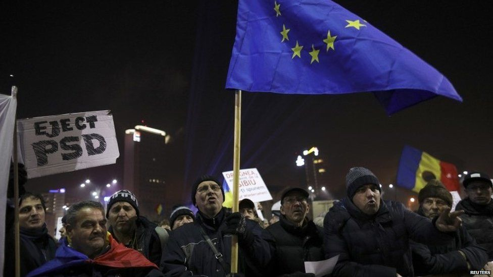 Protesters hold EU flag during a demonstration in Bucharest, Romania, February 5, 2017.