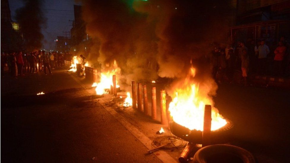 Protesters burn tries on road they protest against the Citizenship Amendment Bill 2019 in Guwahati Assam, India, 11 December 2019