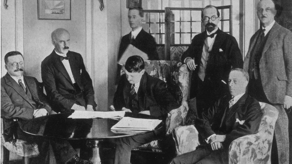 Michael Collins signing the Anglo-Irish Treaty on 6 December 1921