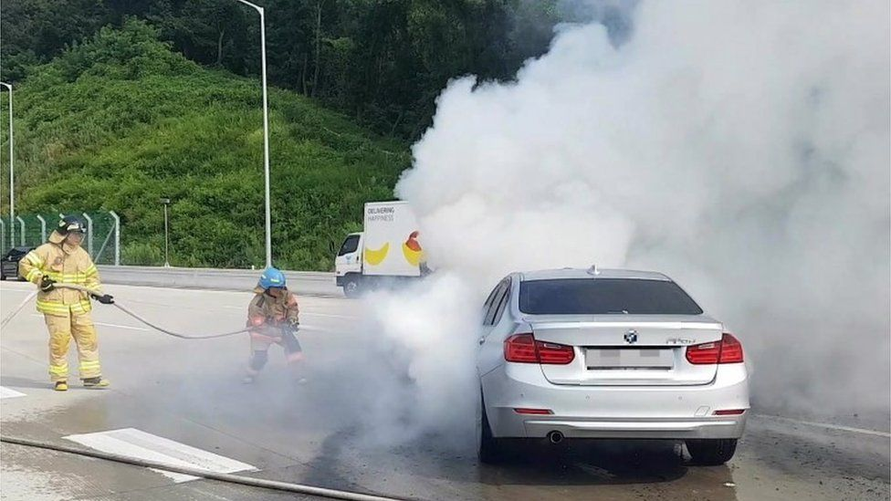 Firemen put out a burning BMW in Uiwang, Gyeonggi Province, South Korea (9 Aug 2018)