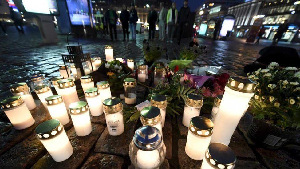 Candles are lit at the scene of the stabbings in Turku