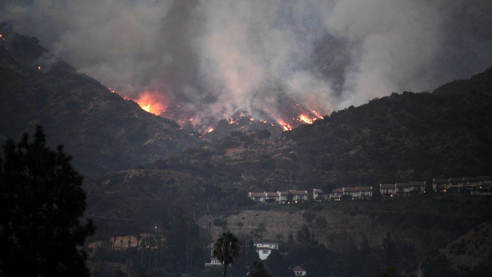 The La Tuna fire burns above downtown Burbank, California, 3 September 2017
