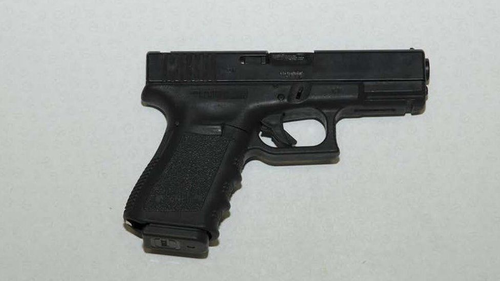 One of the firearms discovered in a concealed compartment at the back of the Honda car.