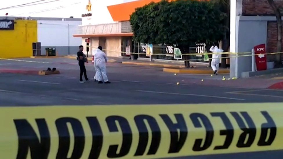 Grab taken from an AFPTV video showing police forensic researchers going through the crime scene at a bus station where armed gunmen killed at least five people and injured one in Cuernavaca, in the Mexican central state of Morelos, on September 2, 2019.