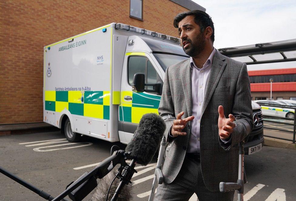 Humza Yousaf next to ambulance