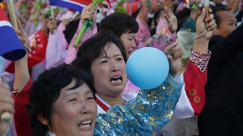 Women are overcome with emotion as they parade past North Korean leader (10 October 2015)
