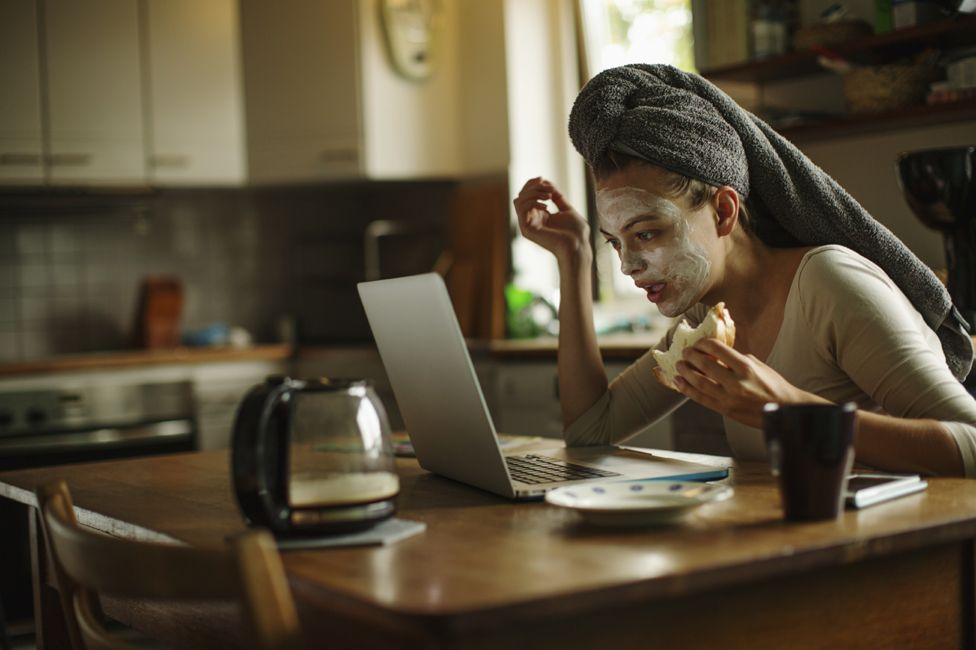 Woman at kitchen table on computer