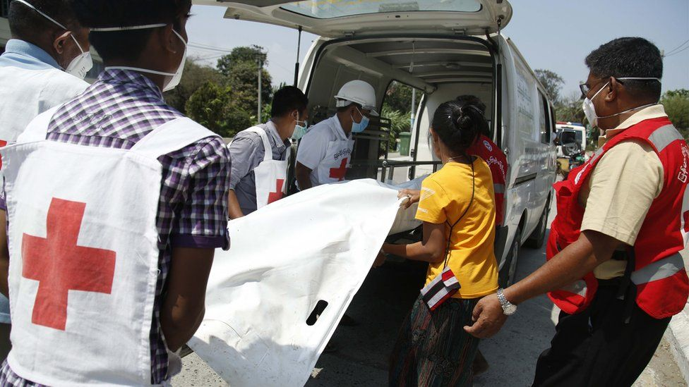 Members of the Myanmar Red Cross society move a the body of Pyae Sone Win Maung from a boat to an ambulance that will transport to Sittwe Hospital, in Sittwe, Rakhine State, western Myanmar, 21 April 2020