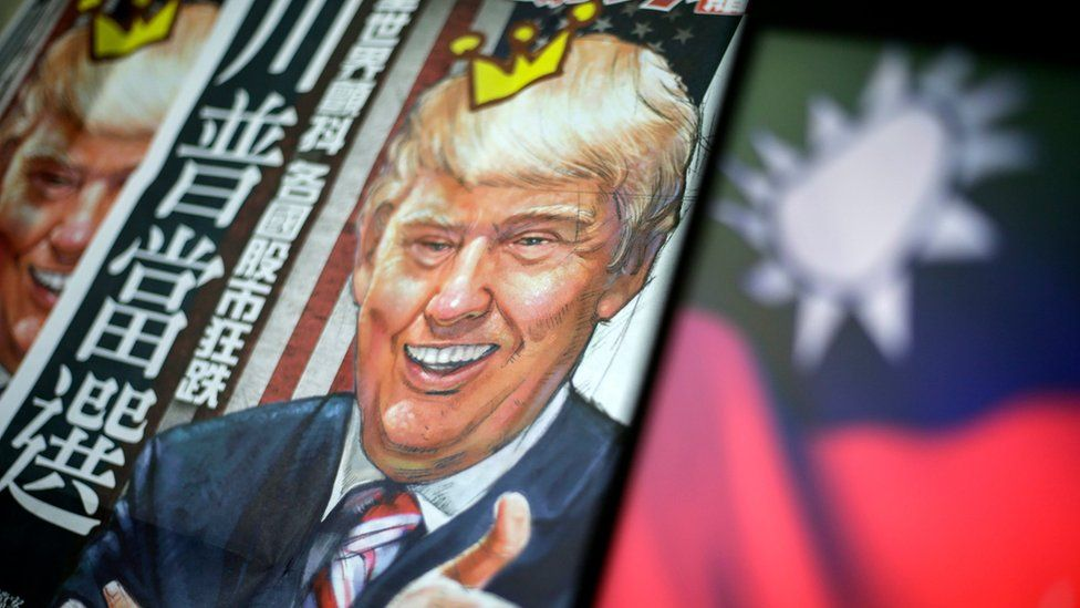 A newspaper headline with the illustration of US President-elect Donald Trump is pictured next to the flag of Taiwan in Taipei, Taiwan, 12 December 2016
