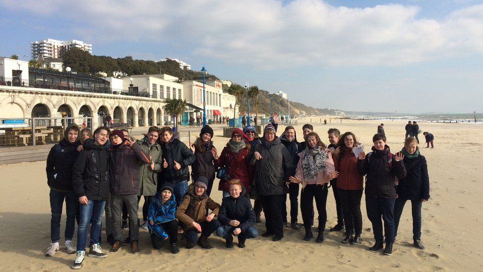 German teachers Anne Ritcher and Stephanie Schmidt with some of their students on Bournemouth beach
