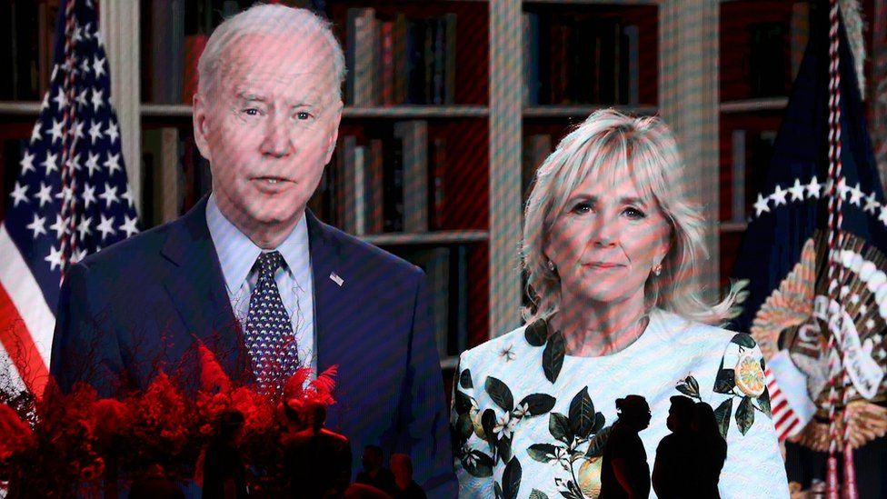 US President Joe Biden and First Lady Jill Biden speak in a video message