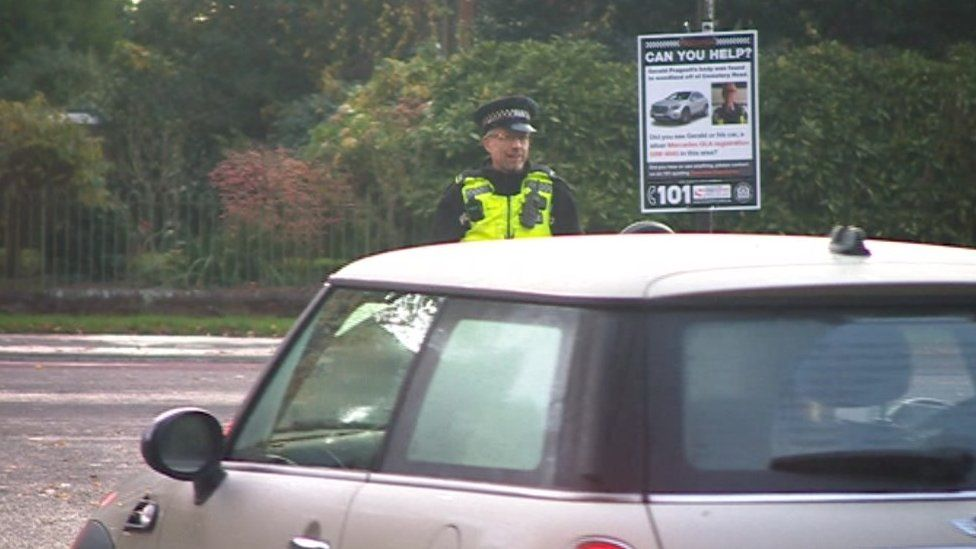 Police questioning motorists and passers-by