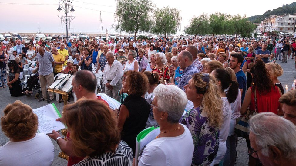 A mass is held at the Church of the Immaculate in Scario on 18 August 18