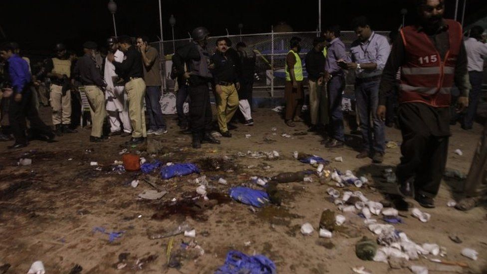 Officials inspect the scene of the attack in Lahore