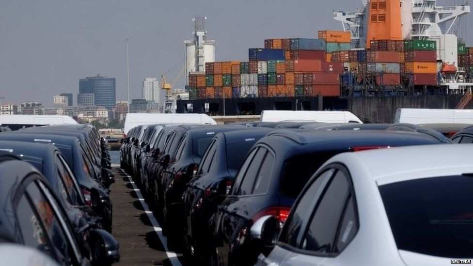 Cars waiting to board a ship for export in the Spanish port of Valencia