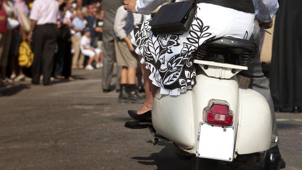 Italians on scooter