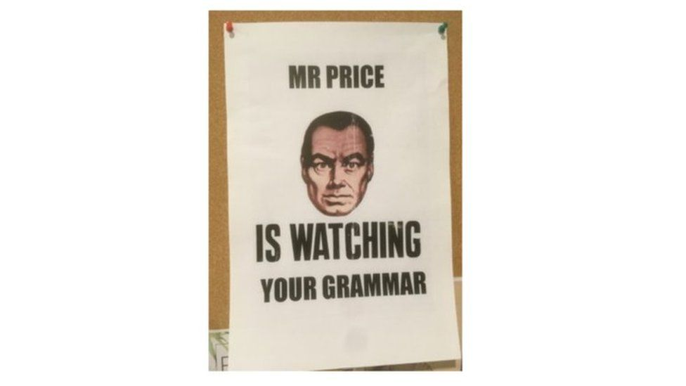 "A poster saying ""Mr Price is watching you"""