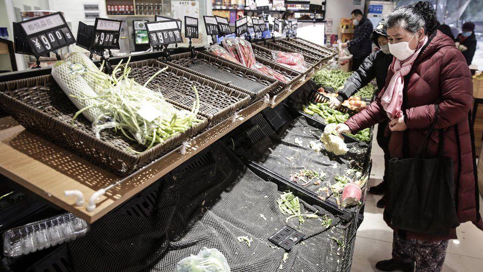 Empty supermarket shelves in Wuhan