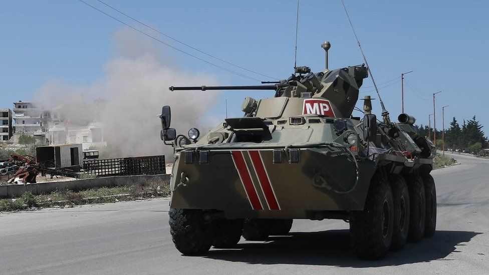 A Russian military police armoured personnel carrier drives along the M4 highway in Idlib province, Syria (12 May 2020)