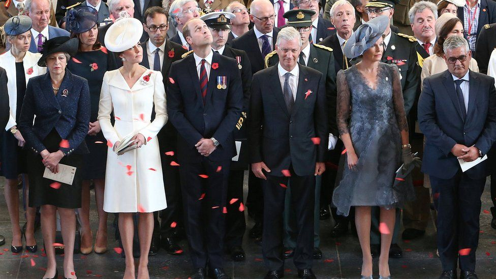 The prime minister stands alongside the Duke and Duchess of Cambridge, and the King and Queen of Belgium, under Menin Gate