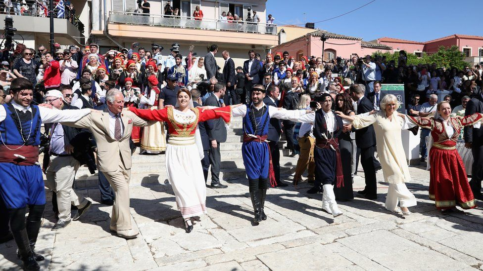 On a visit to Crete, Prince Charles and the Duchess of Cornwall take part in traditional dancing