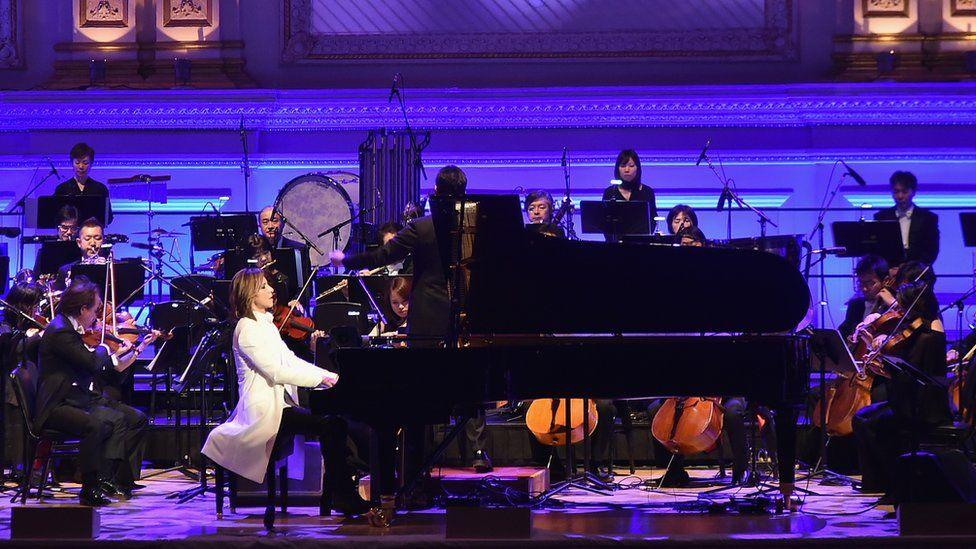 Yoshiki playing piano