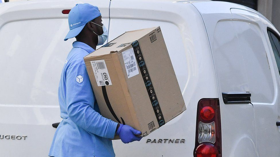 Amazon delivery worker in mask and gloves