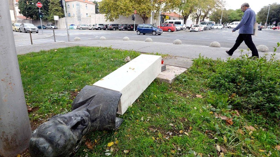 A man walks by a toppled down monument of Croatia's World War Two partisan, Rade Koncar, on 7 November 2018 in Split, Croatia