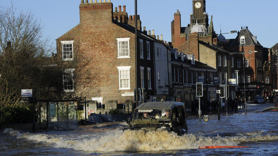 Army vehicle in flooded streets in York on 27 December 2015