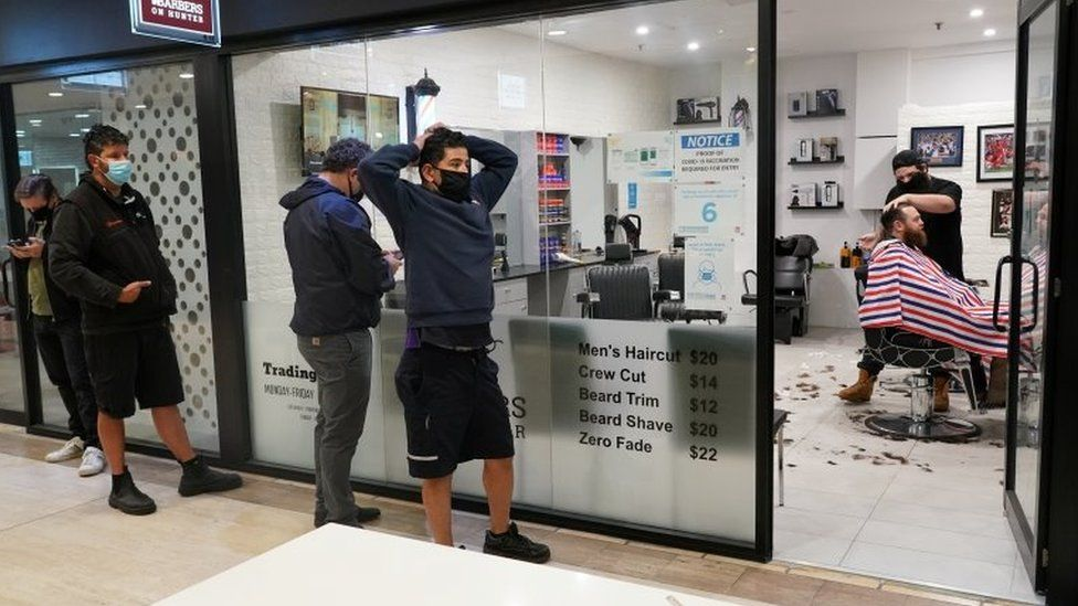 A queue outside a barber shop in Sydney on Monday