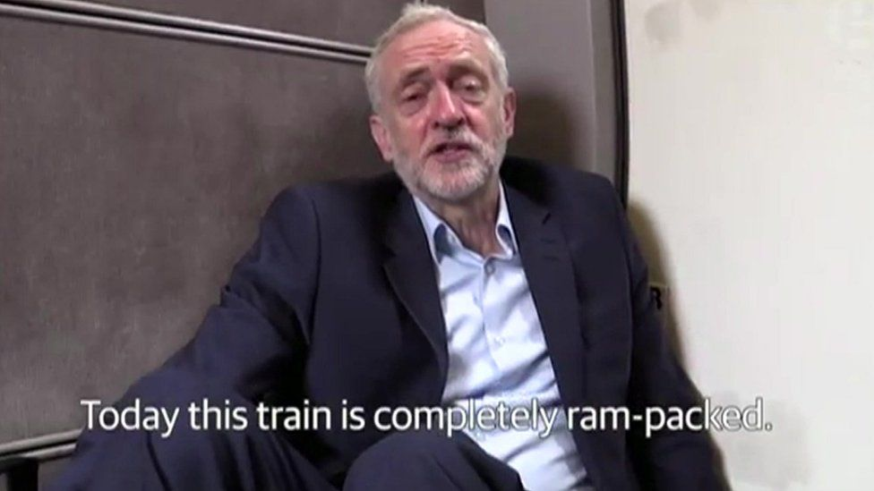 Jeremy Corbyn sitting on the floor of a train