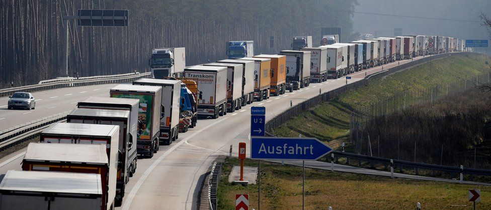 Trucks stuck in a jam on a highway near Fuerstenwalde, southeast of Berlin and about 50km from the Polish border, on 18 March 2020,