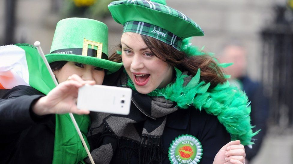Two women take a selfie during the St Patrick's Day Parade in Dublin, Ireland, 17 March 2017