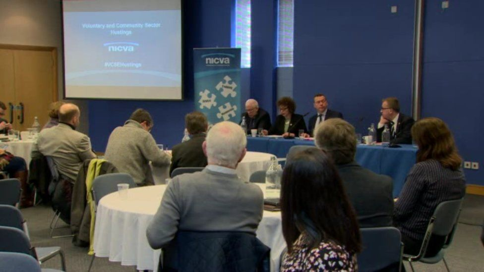 People, including election candidates, at the NICVA hustings event