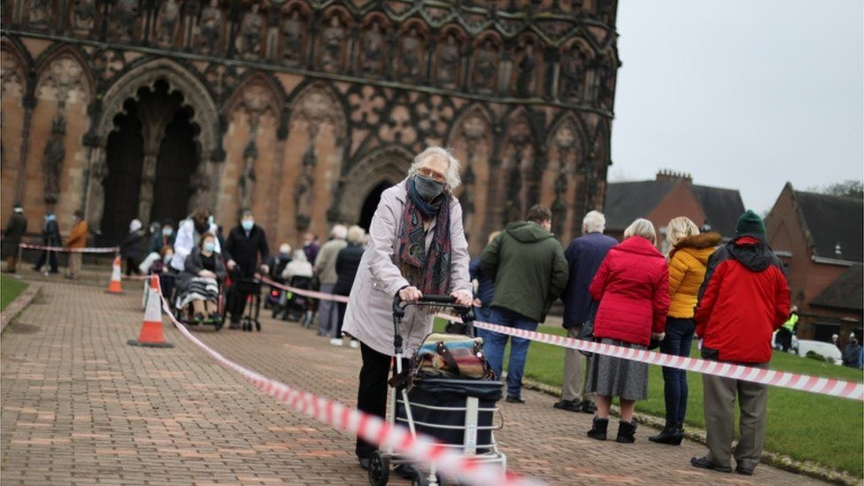 People queue to receive their COVID 19 vaccines inside Lichfield Cathedral