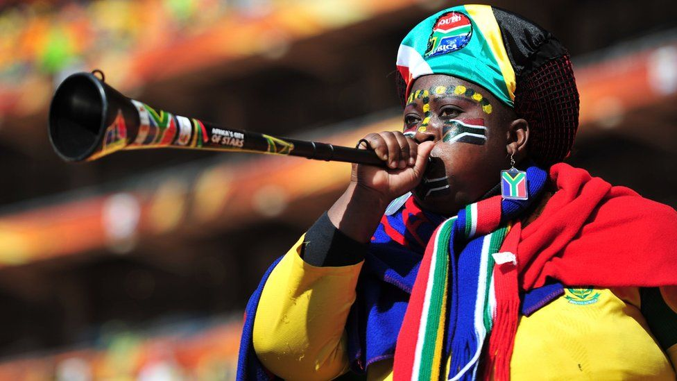 A South Africa supporter blows a Vuvuzela at the 2010 FIFA World Cup in South Africa on 11 June, 2010