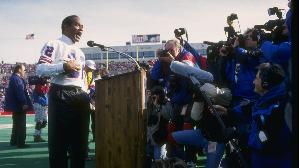 O.J. Simpson on the mike during a half-time ceremony of a game between the Buffalo Bills and the Indianapolis Colts at Rich Stadium in Orchard Park, New York, in 1993.
