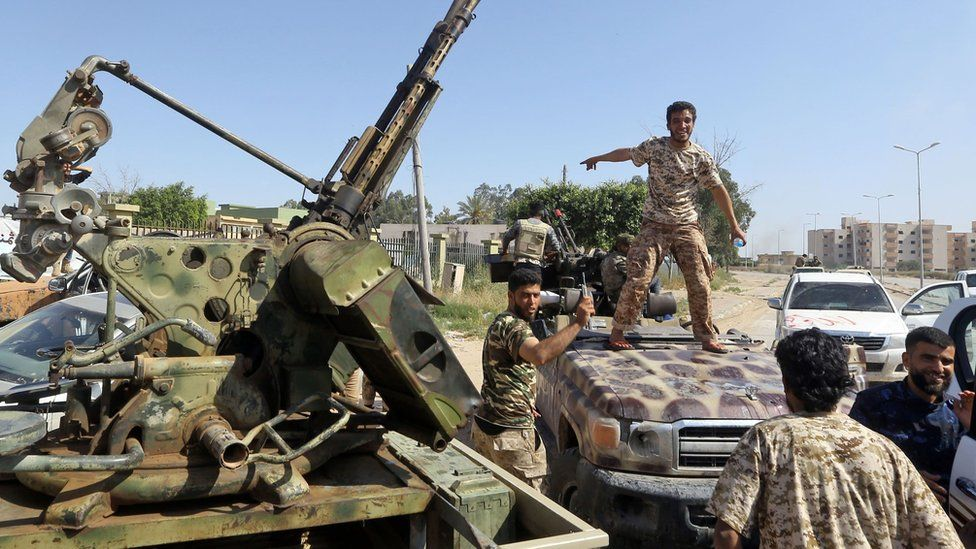 pro-government forces south of Tripoli