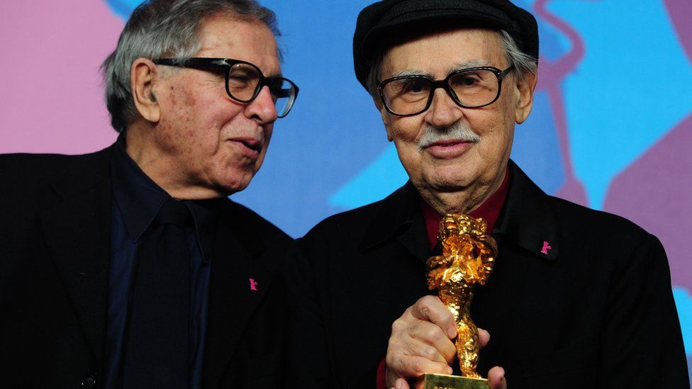 """Italian directors Vittorio (R) and Paolo Taviani receive the Golden Bear prize awarded for their film """"Caesar Must Die"""