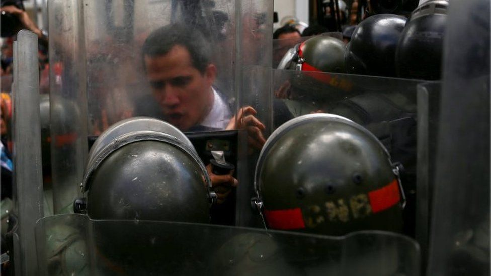 Mr Guaidó pushes against a riot shield on 7 January 2020